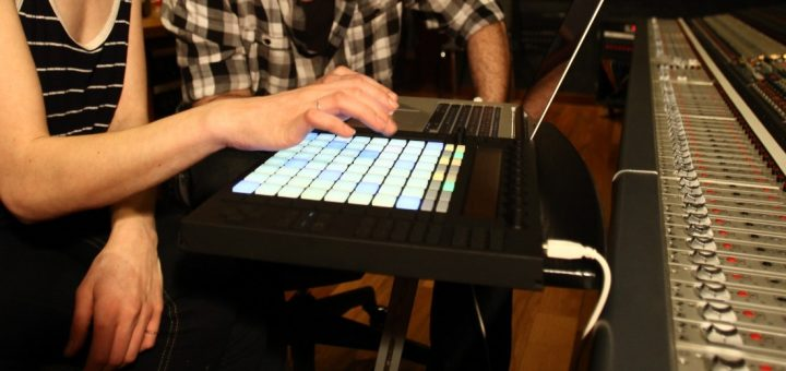 Two people working with Ableton Push