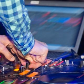 DJ operating gear during a show